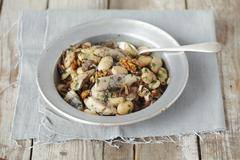 Herring salad with beans, dried mushrooms, onions and walnuts Stock Photos