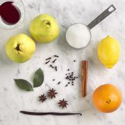 Ingredients for Poaching Quince; Quince, Cinnamon, Orange, Lemon, Sugar, Stock Photos