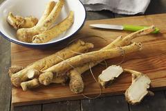 Fresh horseradish roots Stock Photos