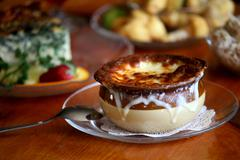 Bowl of French Onion Soup on a Glass Plate Stock Photos