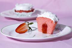 Strawberry jam filled cupcake Stock Photos