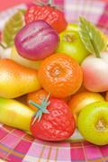 An assortment of colourful marzipan fruits Stock Photos