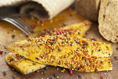 Smoked mackerel fillet (North Atlantic) spiced with pepper, paprika and mustard Stock Photos