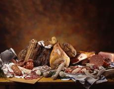 A still life with an assortment of Italian hams, salamis and sausages Stock Photos