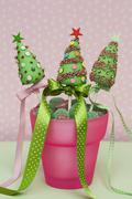 Christmas cake pops in a pot with candies Stock Photos
