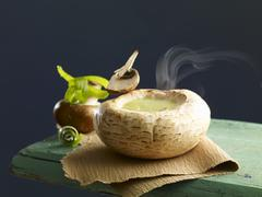 Cream of mushrooms soup served in a scooped out mushroom cap Stock Photos