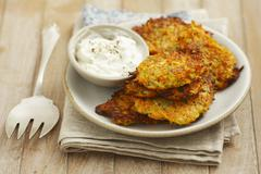 Carrot fritters with yoghurt dip Stock Photos
