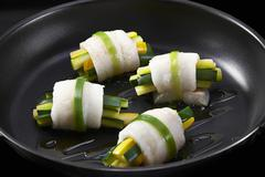 Zander fish wrapped around courgette batons Stock Photos