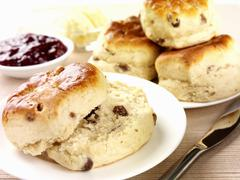 Fruit scones with jam and butter Stock Photos