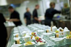 Waiters preparing a buffet of starters Kuvituskuvat