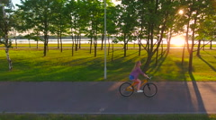 Young sexy woman riding a bike at dawn. 4K 30fps ProRes (HQ) Stock Footage