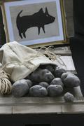 Truffle potatoes in a potato sack, and a drawing of a pig Stock Photos