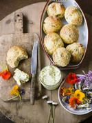 Herb rolls with herb butter and edible flowers Stock Photos
