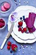 Home-made berry ice lollies Stock Photos