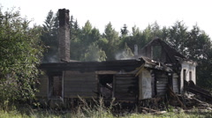 Wooden farmhouse after a fire Stock Footage
