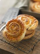 Puff pastry whirls with cheese Stock Photos