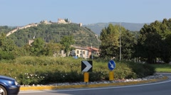 Close view of roundabout with cars and the Marostica castle on background Stock Footage