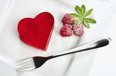 Heart shaped red jello dessert on a plate Stock Photos