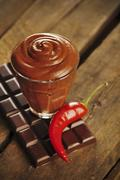 Chocolate mousse and chocolate bar with chilie Stock Photos