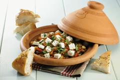 Vegetarian Tagine with chick peas and sheep s milk cheese, selective focus Stock Photos