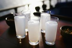 Five glasses of Raki with water (aniseed schnapps, Turkey) Stock Photos