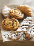 Raisin whirls, croissants and chocolate-chip puff pastry twists Stock Photos