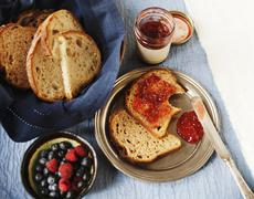 Bread with Jam, A Bowl of Fresh Berries and a Basket of Sliced Bread Stock Photos