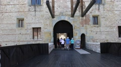 Tourists entering a castle Stock Footage