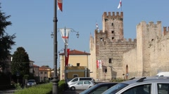 A medieval flag and the Marostica lower castle (Castello Inferiore)  [tilt up] Stock Footage