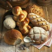 Assorted types of bread and a Hefezopf (sweet bread from southern Germany) on a Stock Photos