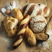 Assorted types of bread on a wooden surface Stock Photos