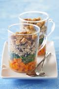 A layered starter with croutons and smoked mackerel Stock Photos
