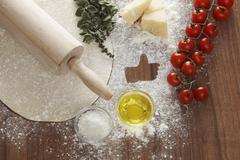Ingredients for a margherita pizza, with a 'like' symbol Stock Photos