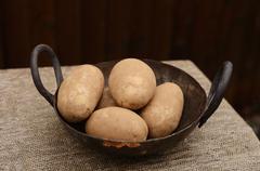 Idaho Potatoes in an Old Wok Stock Photos