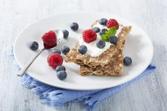Crisp breads with fresh berries and crème fraiche Stock Photos