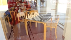Table with chess game and reflexes of tourists and traffic Stock Footage