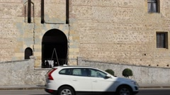 Entrance arch of Marostica lower castle with traffic and pedestrian Stock Footage