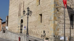 Sunny Marostica lower castle facade (Castello Inferiore) with medieval flags Stock Footage