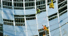 Construction workers install glass windows at development site in Los Angeles 4K Stock Footage