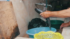 Cleans Fish. Rinse fish Water from the Tap Stock Footage