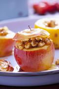 Baked apples stuffed with nuts and honey Stock Photos