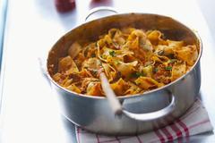 Pappardelle bolognese in a saucepan Stock Photos