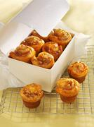 Cinnamon whirl muffins with apple Stock Photos
