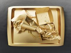 The remains of a fast food meal on a gold-coloured tray Stock Photos