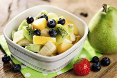 Healthy fresh fruit salad, selective focus Stock Photos