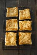 Puff pastry slices with sliced almonds Stock Photos