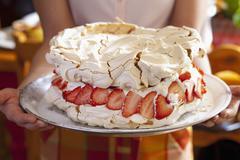 Pavlova with creamy lemon filling and strawberries Stock Photos