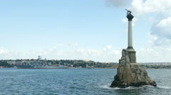 Flagship and the Monument to the Scuttled ships in Sevastopol Stock Footage