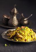 Pilau with cinnamon and almonds (North Africa) Stock Photos