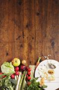 Vegetables and fruit on a wooden slab Stock Photos